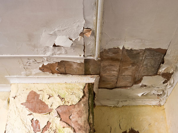 Ceiling damaged by water leak at property in Manchester